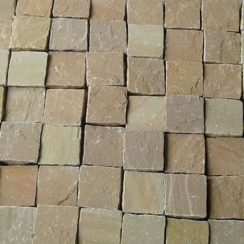 LALITPUR YELLOW COBBLES EXPORTER RACHANA STONES INDIA